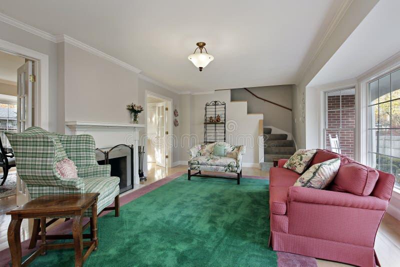 Z zielonym carpeting żywy pokój fotografia royalty free
