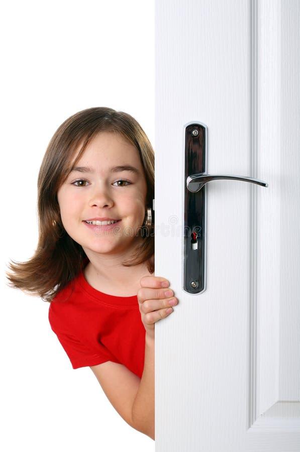 za drzwiową dziewczyną zdjęcia royalty free