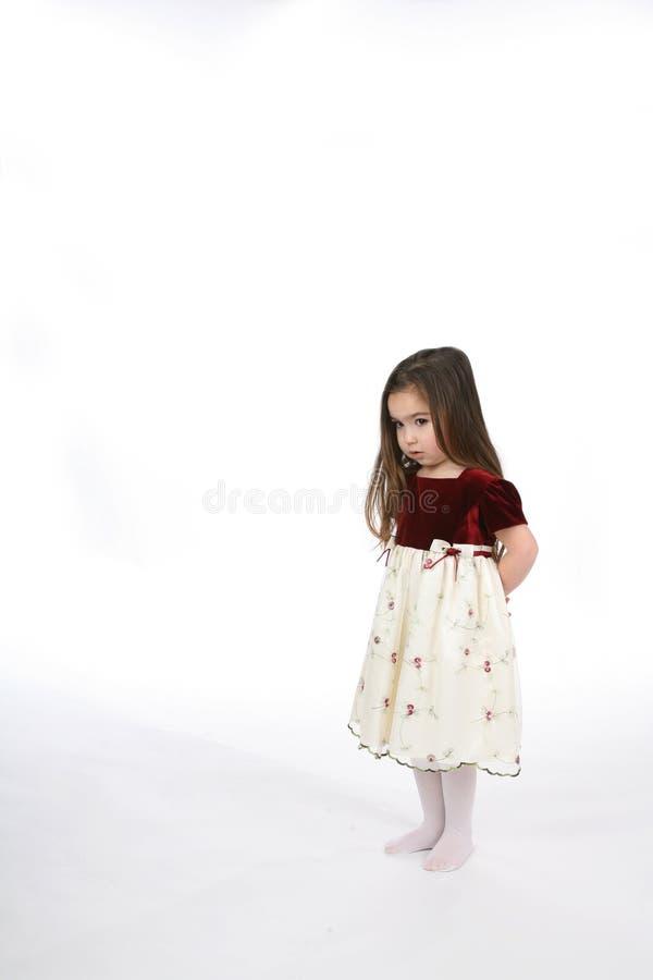 - za dziewczyną podaj jej małego obrazy royalty free