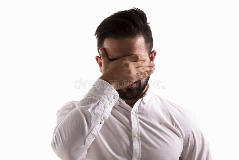Zaaferowany przystojny mężczyzna obraz stock