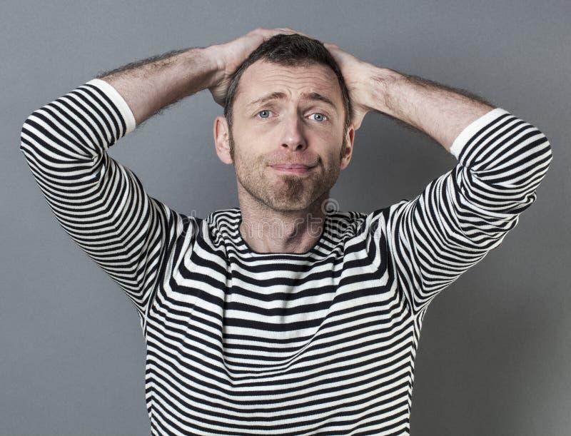 Zaaferowany w średnim wieku mężczyzna obrazy stock