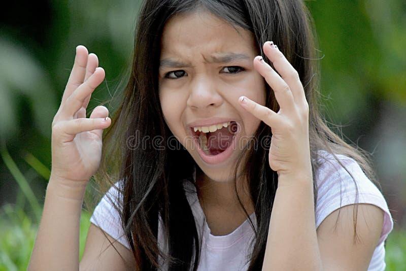 Zaakcentowana Śliczna filipinka dziewczyna zdjęcia stock