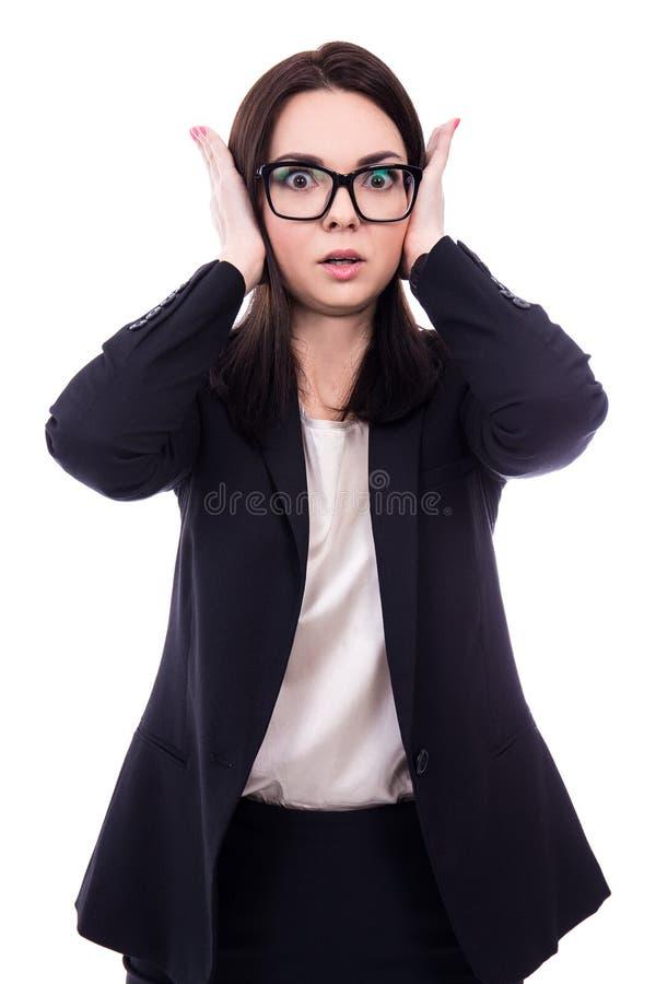 Zaakcentowana młoda biznesowa kobieta zakrywa jej ucho odizolowywających na whit obrazy stock