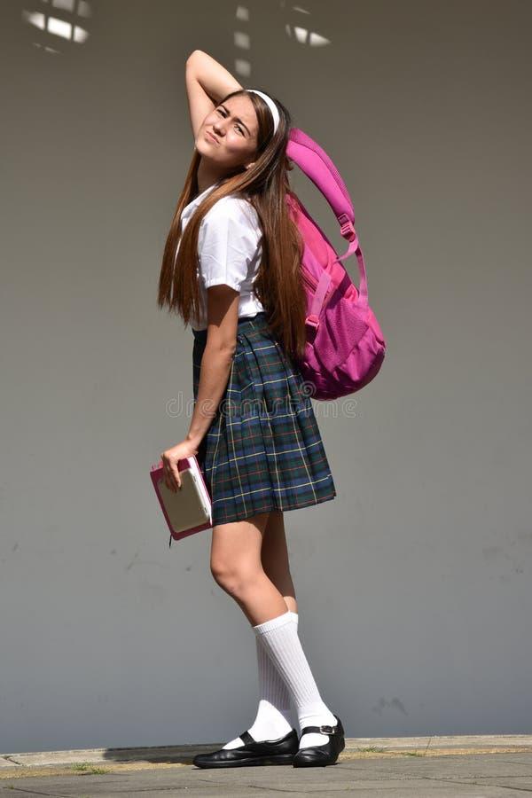 Zaakcentowany Śliczny Kolumbijski dziewczyna uczeń Podczas gdy Stojący zdjęcia royalty free