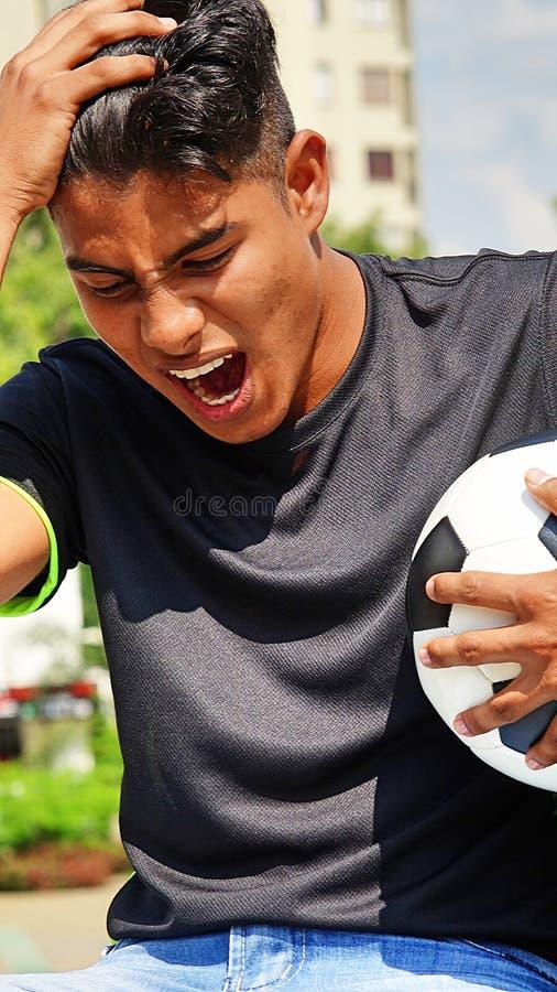 Zaakcentowany Męski gracz piłki nożnej zdjęcia royalty free
