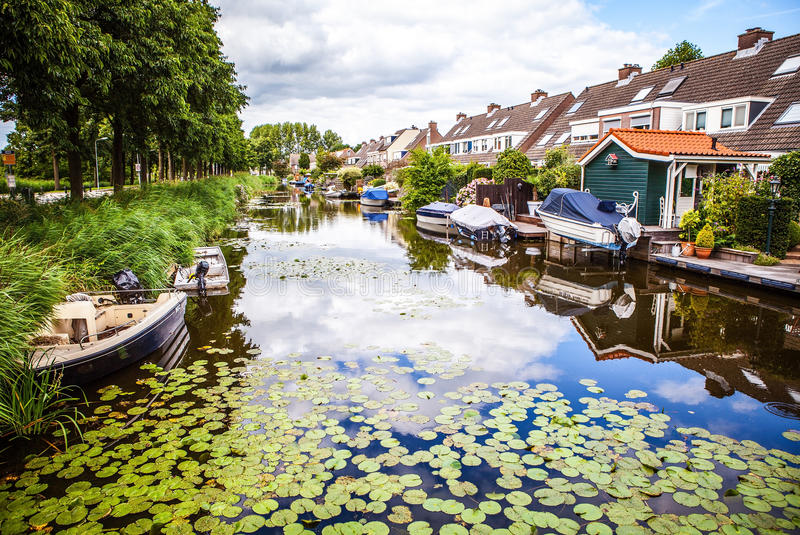 ZAANDAM, NETHERLANDS - AUGUST 14, 2016: Traditional residential Dutch buildings close-up. General landscape view of city royalty free stock image