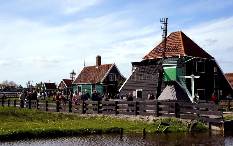 Zaanse Schans. Buildings and windmill in Zaanse Schans ethnographic museum in Netherlands royalty free stock images