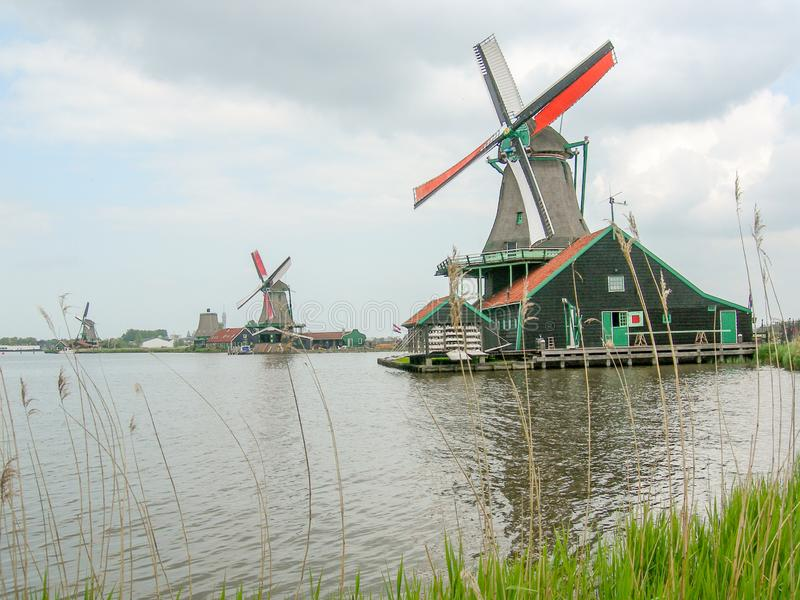 The Zaanse Schans in The Netherlands, with iconic Dutch windmills stock images