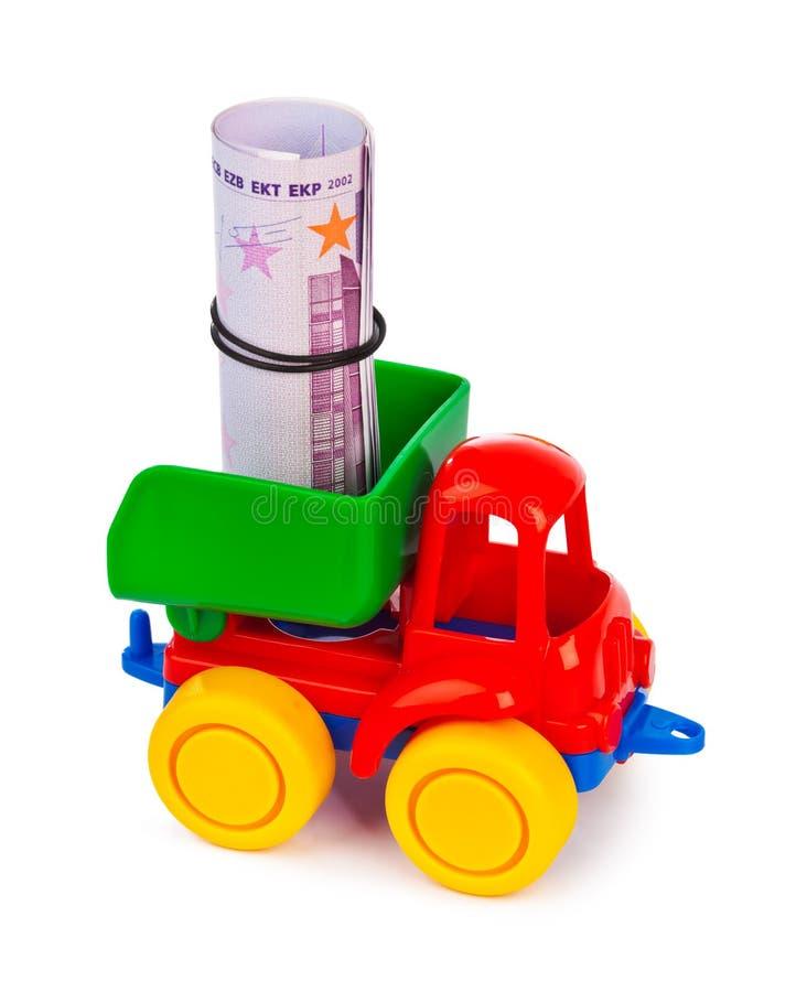Zabawkarska ciężarówka z pieniądze fotografia stock