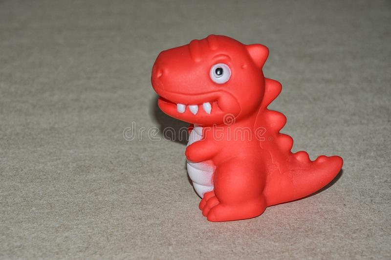 Zabawkarski dinosaur dziecko zabawkarska czerwień zdjęcia royalty free