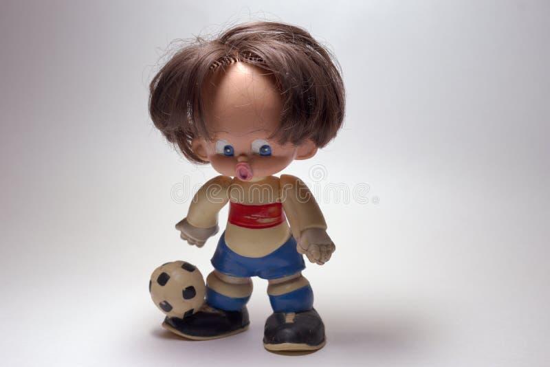 Zabawkarski gracz futbolu w rocznika mundurze Ścinek ścieżka zdjęcie stock