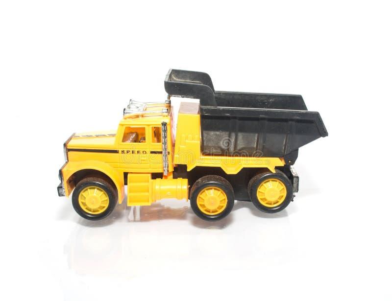 Zabawkarski samochód ciężarówka odizolowywająca na bielu obrazy royalty free