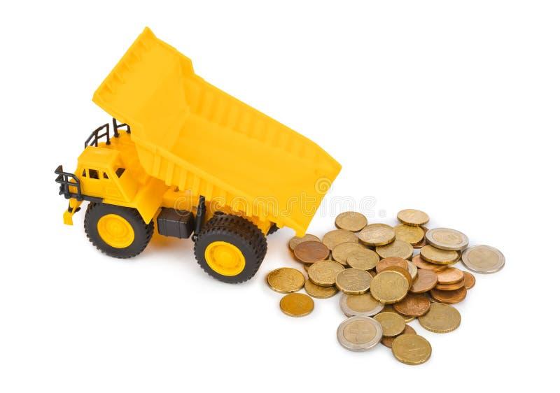 Zabawkarskie samochodu pieniądze i ciężarówki monety fotografia stock