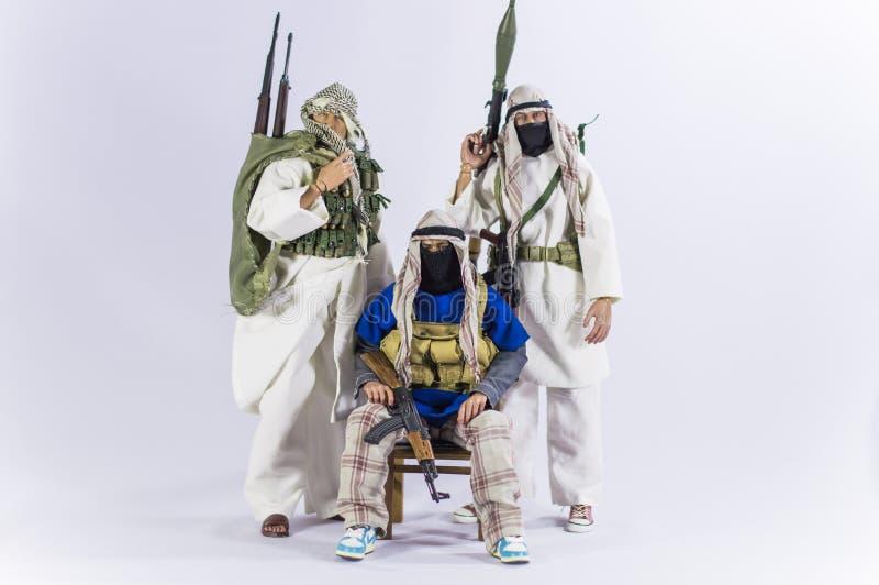 Zabawkarskiej mężczyzna żołnierza akci postaci miniatury realistyczny jedwabniczy biały tło obrazy stock