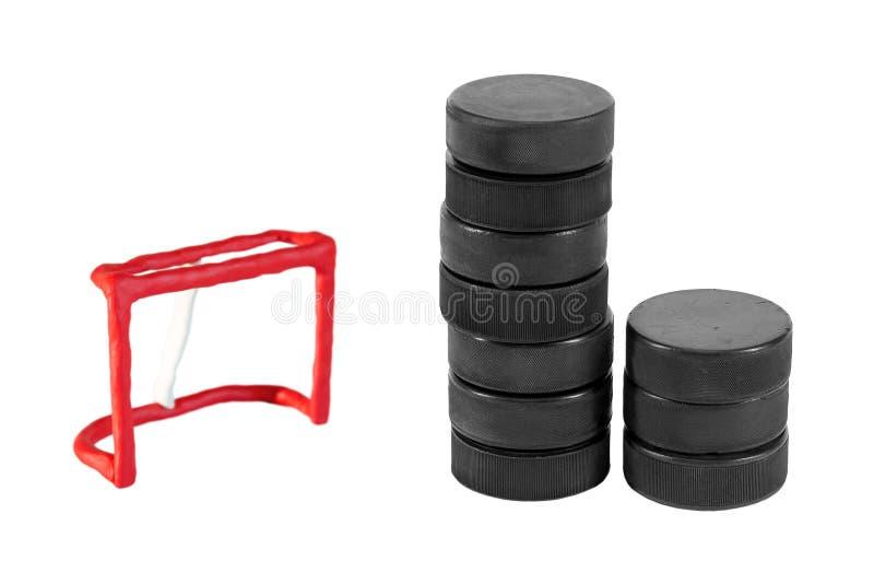 Hokejowy cel i sterta płuczki zdjęcia stock