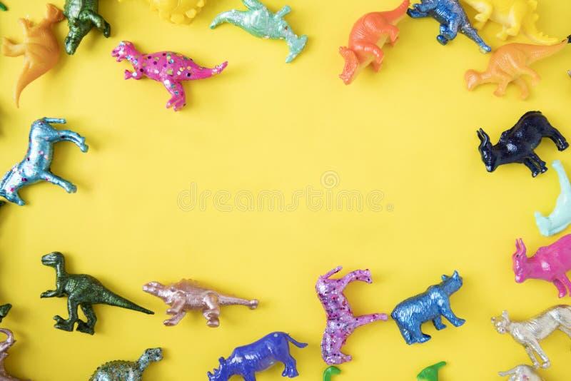 Zabawki z kolorowym dinozaurem z tworzyw sztucznych obrazy royalty free