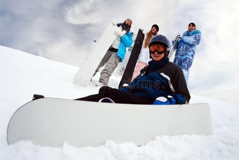 zabawy cztery snowborders zdjęcie royalty free