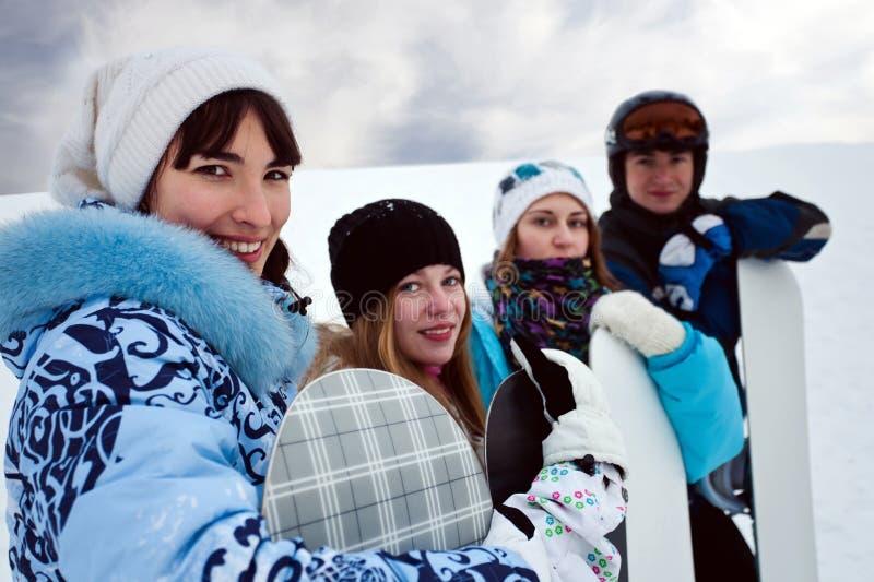 zabawy cztery snowborders zdjęcia stock