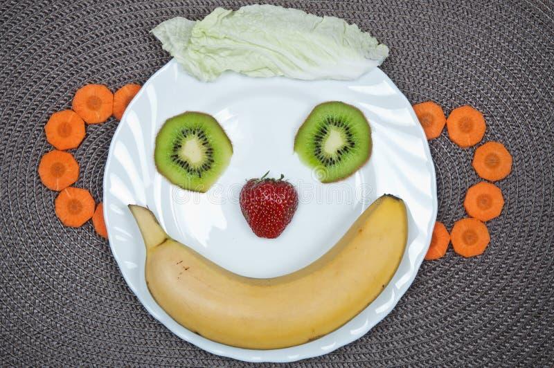 Zabawy jedzenie Bananowy uśmiech fotografia royalty free