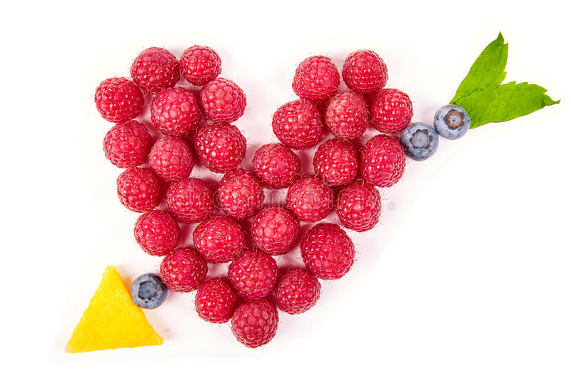 Zabawy jedzenie Serce i strzała robić od owoc fotografia stock