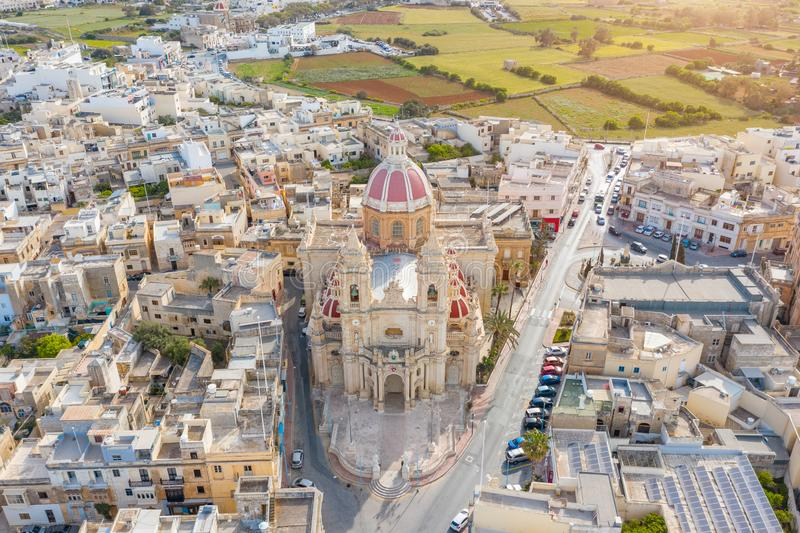 Zabbar Parish Church on the island of Malta, aerial view above, around typical houses buildings.  royalty free stock images