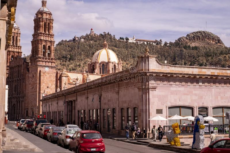 View of the cathedral facade of colonial town with cars parked in front, Zacatecas, Mexico, December 21st, 2017 stock image