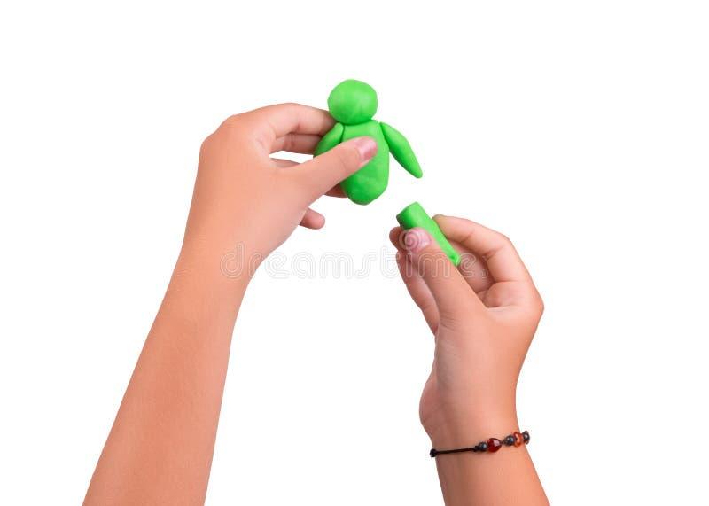 Zacht groen slijm in de handen van een kind stock afbeelding