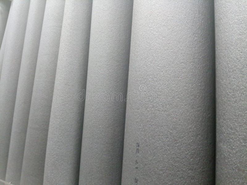 Zachte grijze textuur Thermische isolatie pijpen stock fotografie