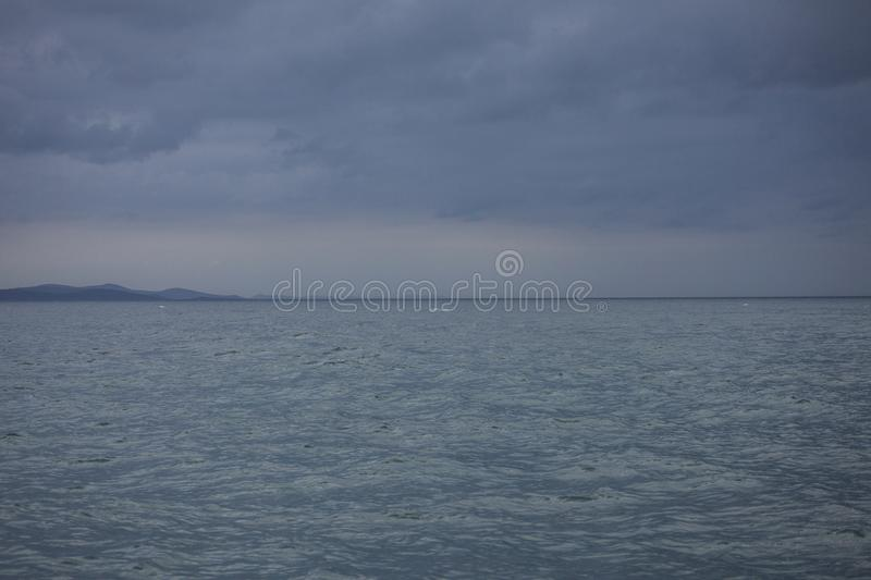 Zadar, Croatia, Europe - blue sea and cloudy skies. This image shows a view of a blue sea and some blue, cloudy skies in Zadar, Croatia, Europe. It was taken in stock photo