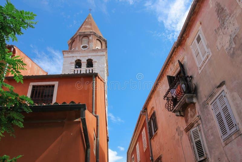 Zadar Croatia old buildings and St. Simon (Sveti Simum) church. Tower of saint Simon church Zadar Croatia and old building with traditional balcony and shutters royalty free stock photos