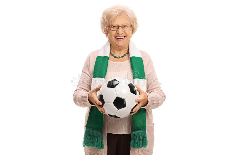 Zadowolony starszy piłki nożnej fan z szalikiem i futbolem zdjęcie royalty free