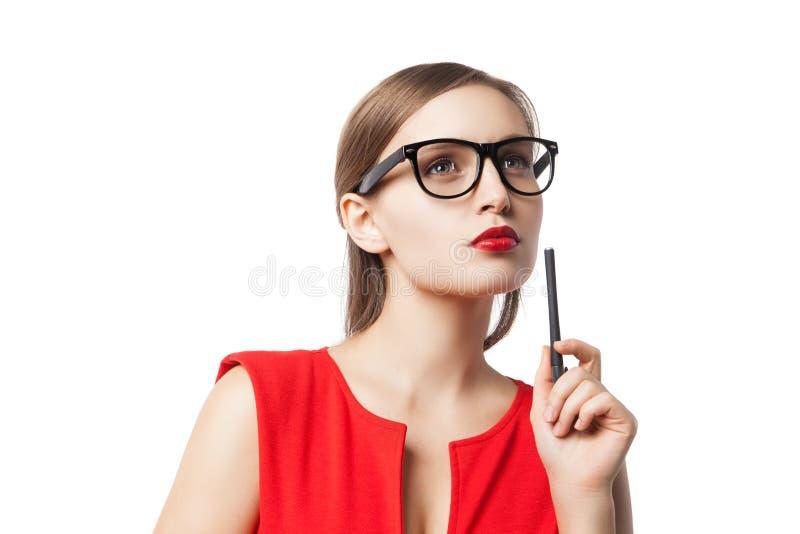 Zadumana młoda kobieta z pióra przyglądający up zdjęcia royalty free