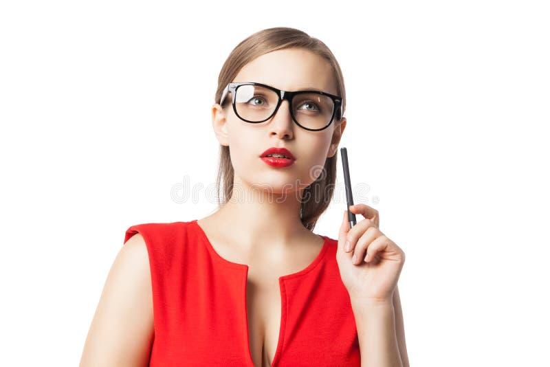 Zadumana młoda kobieta z pióra przyglądający up fotografia royalty free