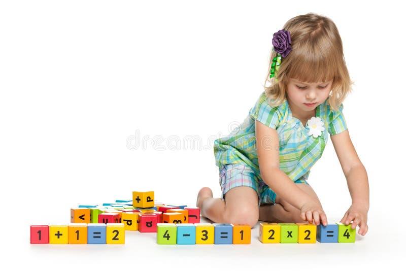 Zadumana mała dziewczynka z blokami fotografia royalty free