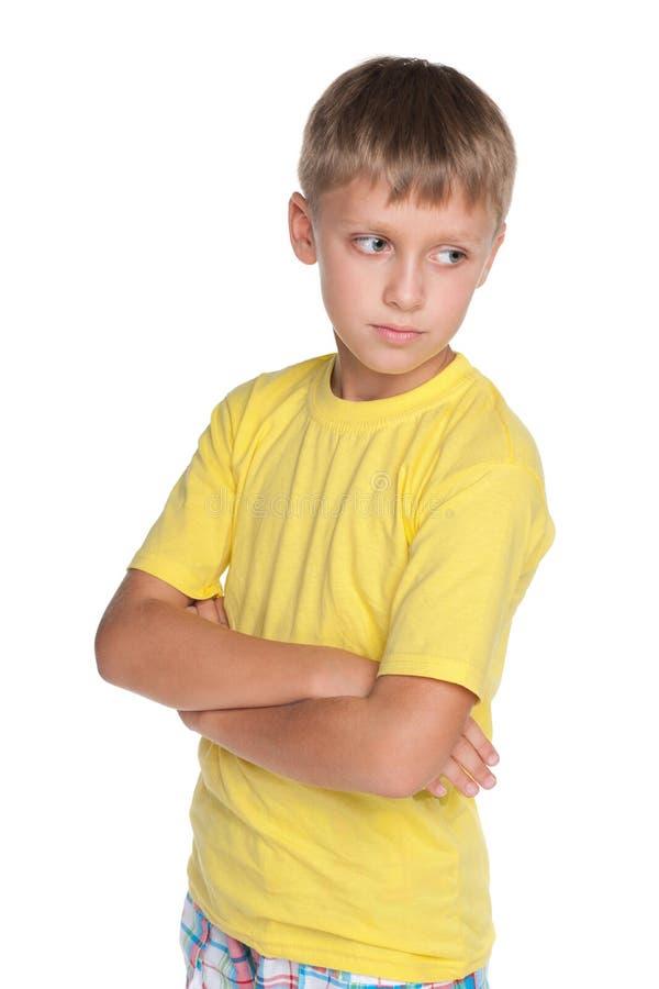 Zadumani młodzi chłopiec spojrzenia na boku obraz royalty free