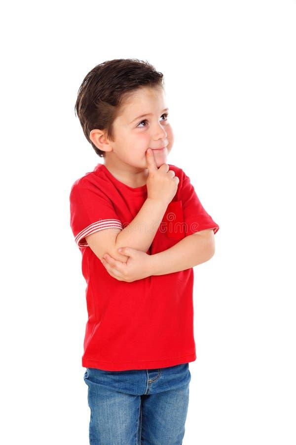 Zadumany dzieciaka wyobrażenie coś zdjęcia stock