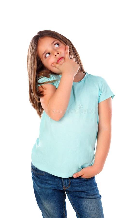 Zadumany mały dziewczyny wyobrażenie coś zdjęcia stock