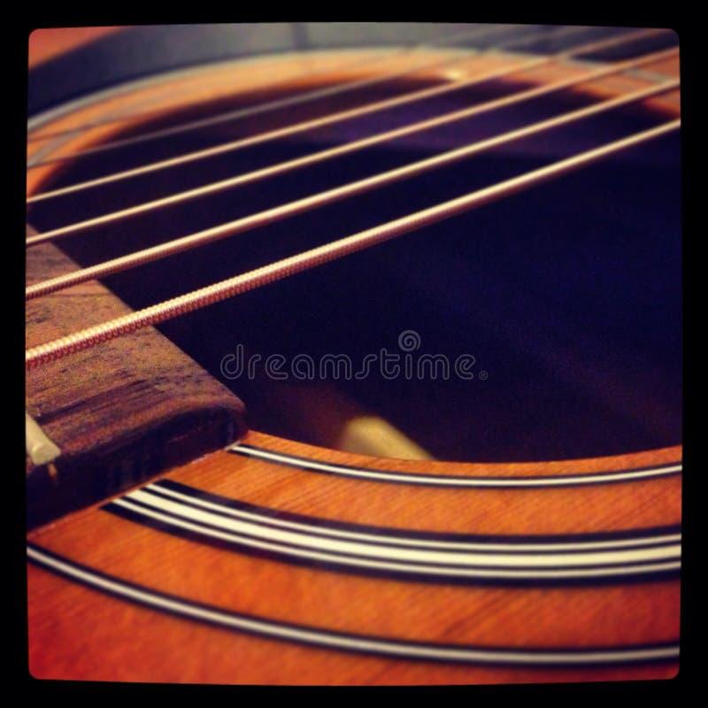 Zadziwiająca gitary akustycznej tła tapeta zdjęcie stock