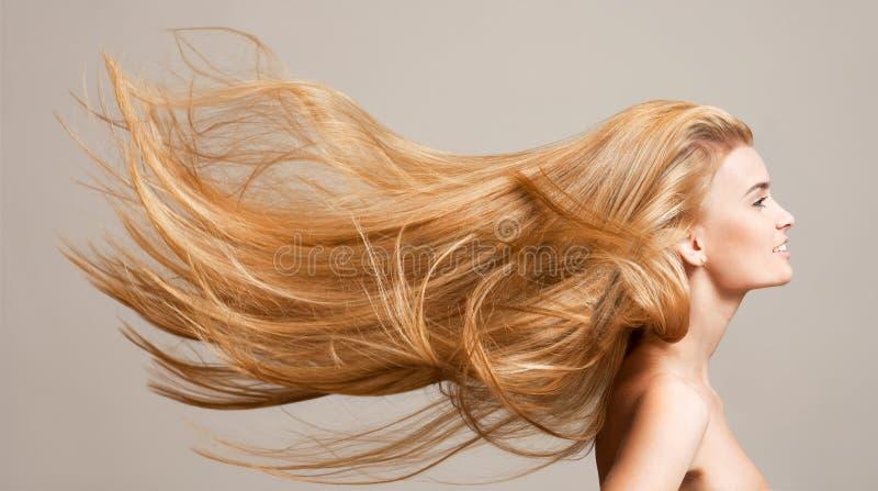 Zadziwiający bieżący włosy zdjęcia stock