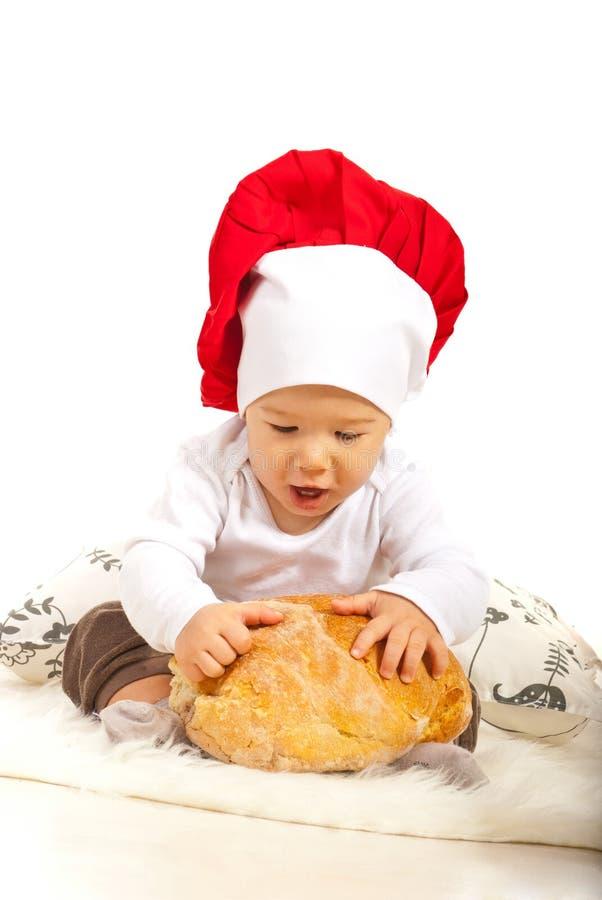 Zadziwiający szefa kuchni dziecko z chlebem zdjęcia stock