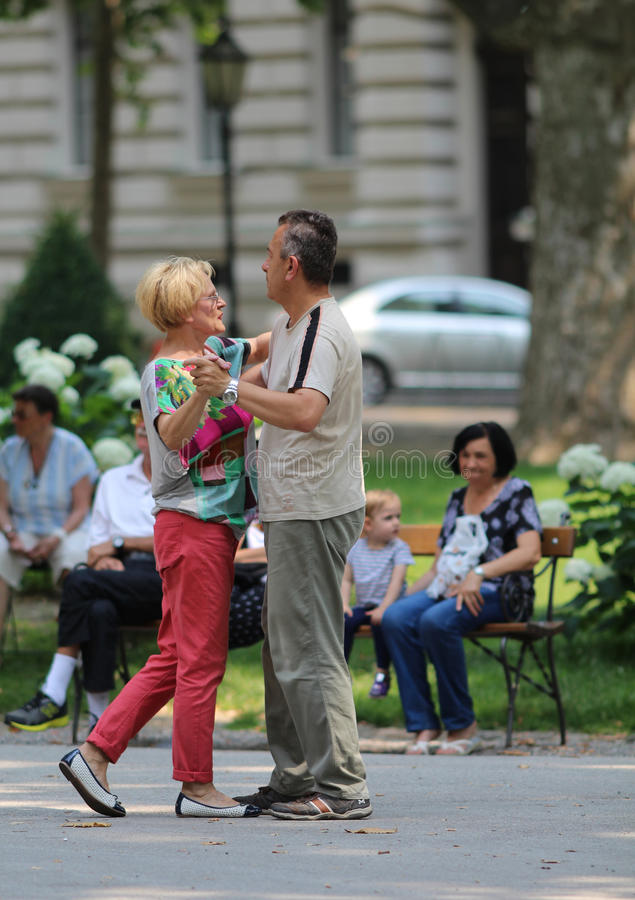 Zagreb, Croatia / Adult Couple Dancing In The Street stock photo