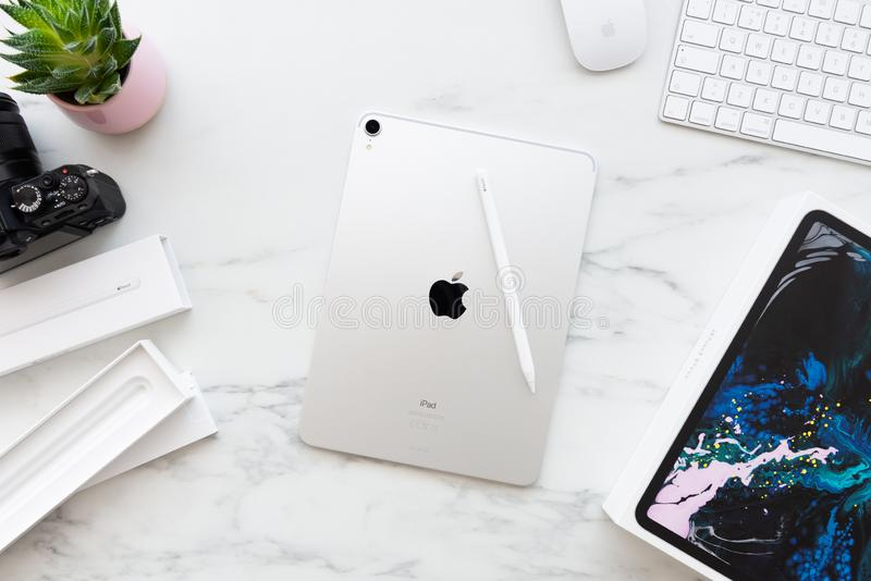 The back of the Apple iPad Pro 11 inch with Apple Pencil 2 on white marble background royalty free stock photo