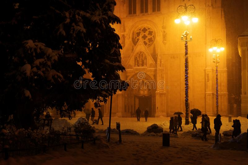 Zagreb, Croatia: January 6 2016: Cathedral of Zagreb in the night during christmastime snowing and orange light, Zagreb, Croatia stock images