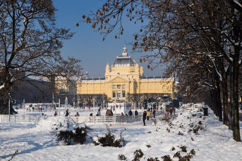 Zagreb, Croatia: January 6 2016: Ice skating park at Ledeni Park in winter with snow with visitors skating around the fountain royalty free stock photos