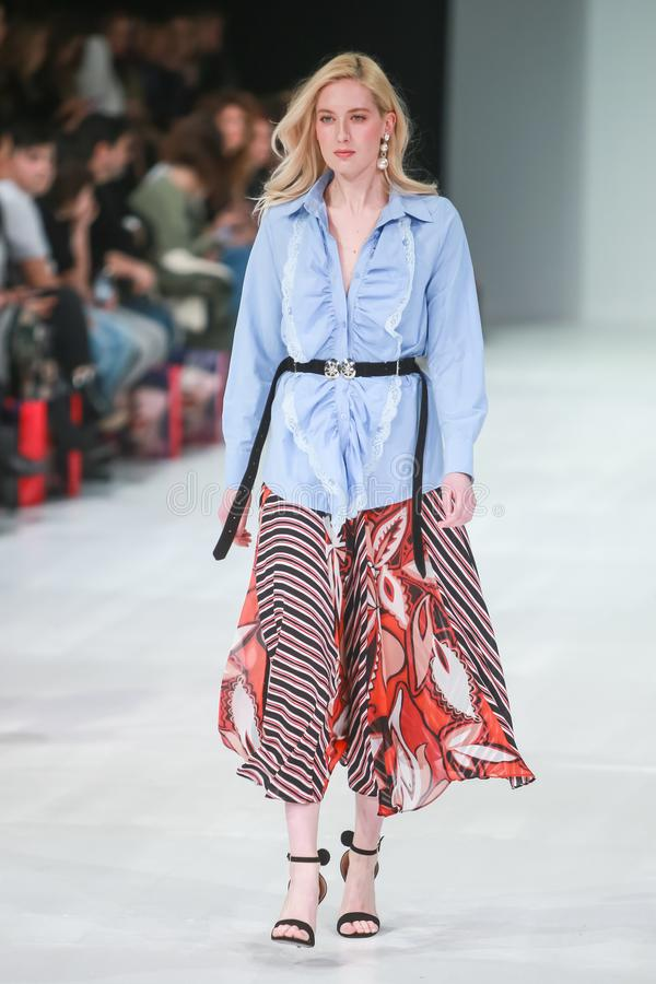 Bipa Fashion.hr fashion show 2018 : Robert Sever. ZAGREB, CROATIA - MARCH 23, 2018 : Fashion model wearing clothes for spring - summer, designed by Robert Sever stock photography