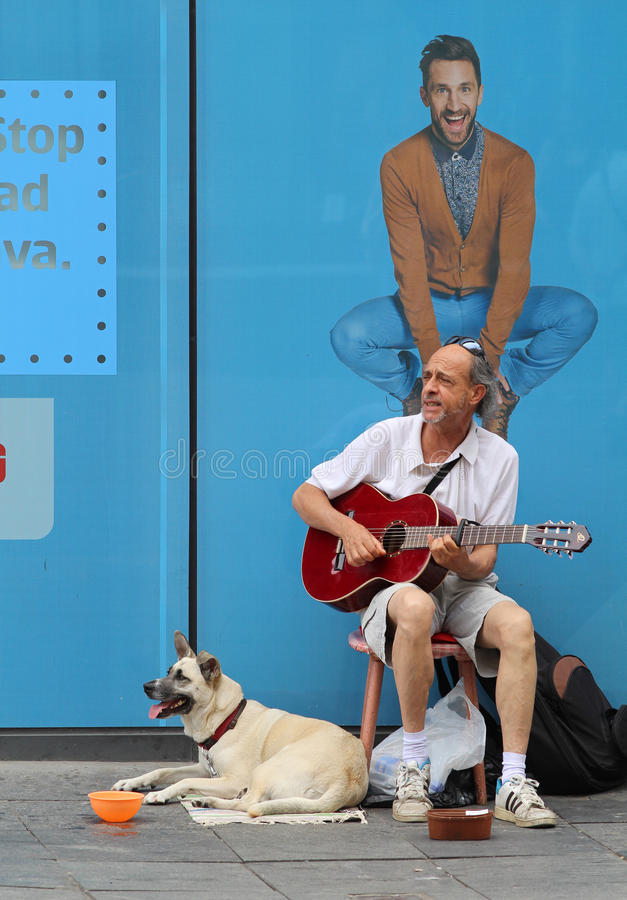 Zagreb Street Musician / Guitar Player With Dog stock image