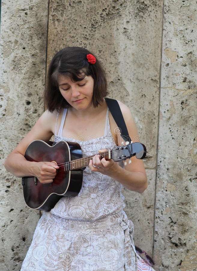 Zagreb Street Musician / Young Woman Playing Tamboura stock images