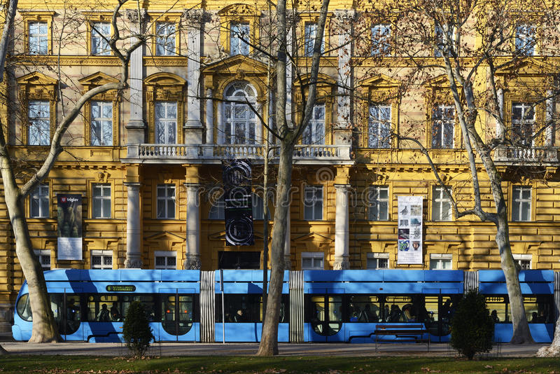 Zagreb tram in front of the Archeology Museum. Zagreb, Croatia - 27 February, 2015: Early morning commuters in Zagrebs' blue tram in front of the Archeologyl royalty free stock image