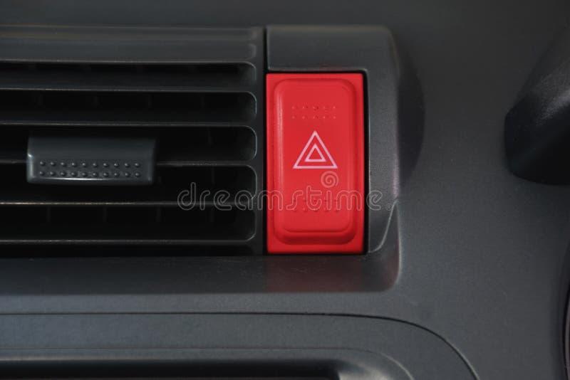 Zagrożenie guzik w frontowej samochodowej konsoli obraz stock