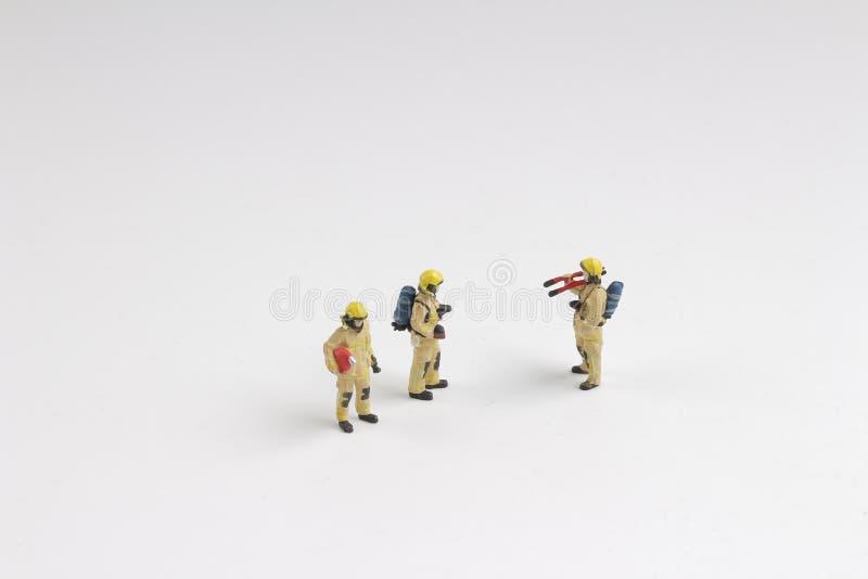 Zahl eines Feuerwehrmannes in der Uniform Berufsleute lizenzfreies stockfoto